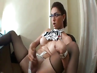 Business woman tranny  pulls on her cock