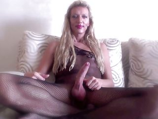 Laura works her dick and cums TWICE in a fishnet catsuit